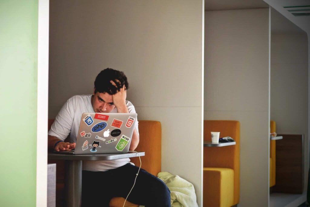 Stressed guy on laptop